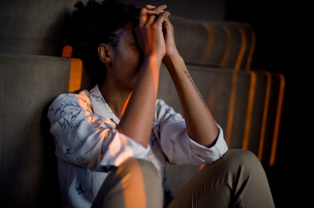 A depressed man in a dark room, mental illness