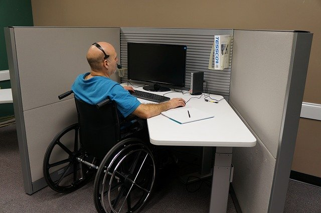 Disabled man sit-down job