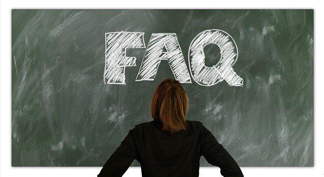 Woman facing FAQ words