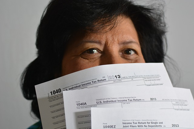 Woman holding her tax return forms