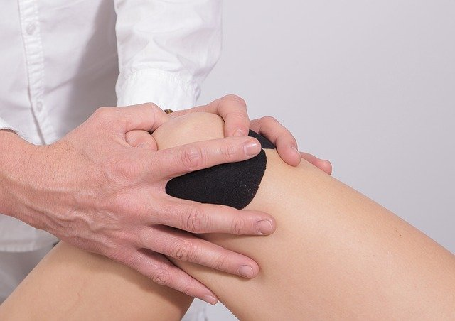 Massaging a painful knee