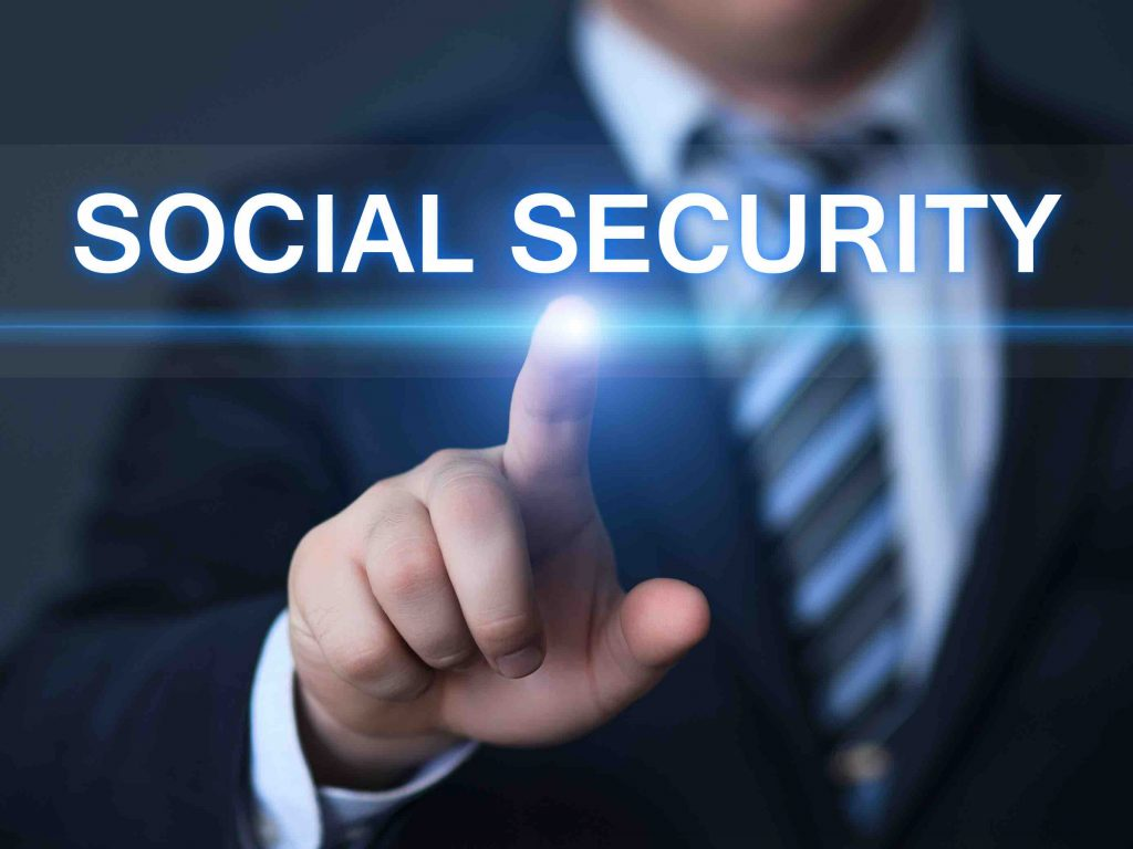 Businessman pointing to social security on screen