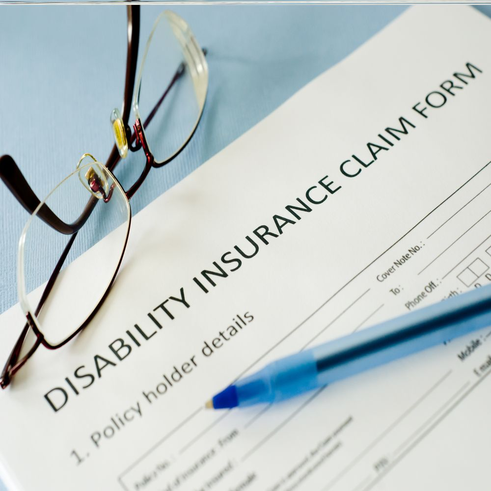Disability insurance claim form with an eyeglass