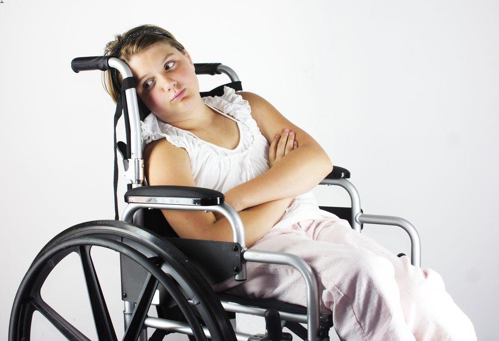 Sad girl in wheelchair